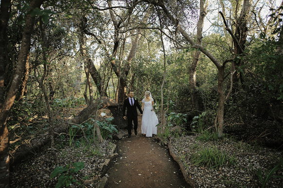 Bride & groom on forest path
