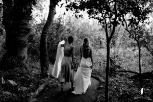 Bride & bridesmaid in forest
