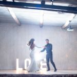 Bride and groom dance on stage